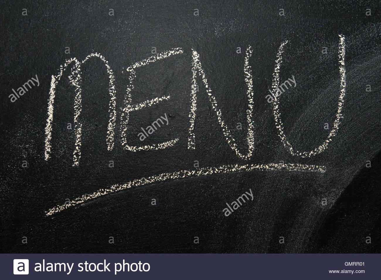 Menu contextuel écrit sur un tableau. Photo Stock
