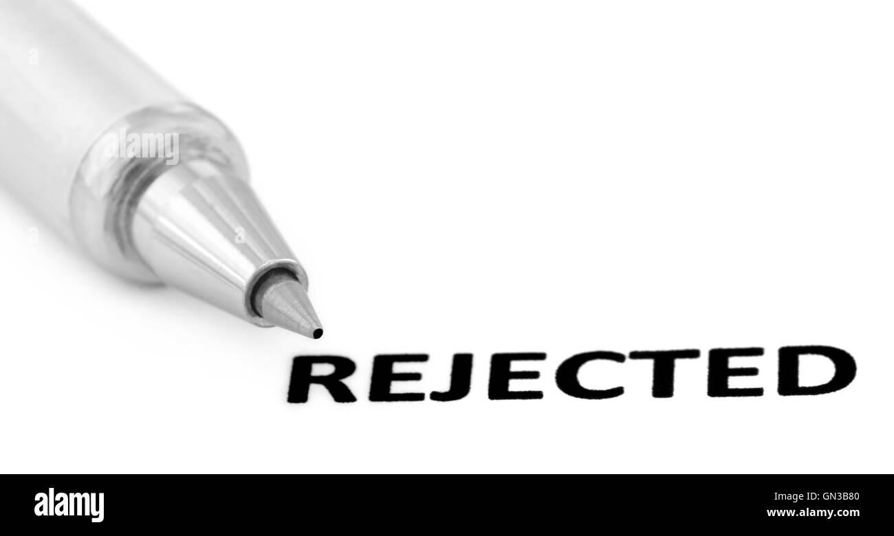 Rejeté imprimé en papier avec un stylo à bille d'argent Photo Stock