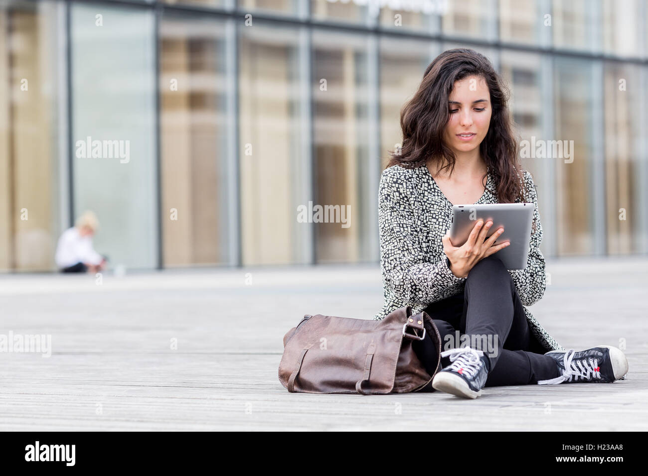 Woman using digital tablet. Photo Stock
