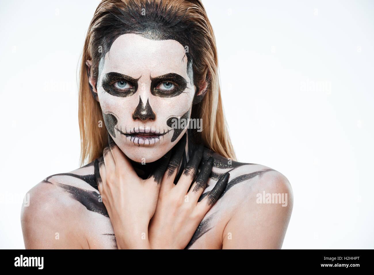 Portrait de fille avec peur maquillage squelette sur fond blanc Photo Stock f8d06af6e2e