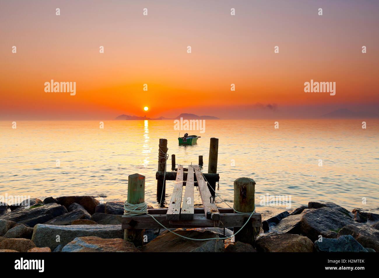 Coucher de soleil jetée Photo Stock