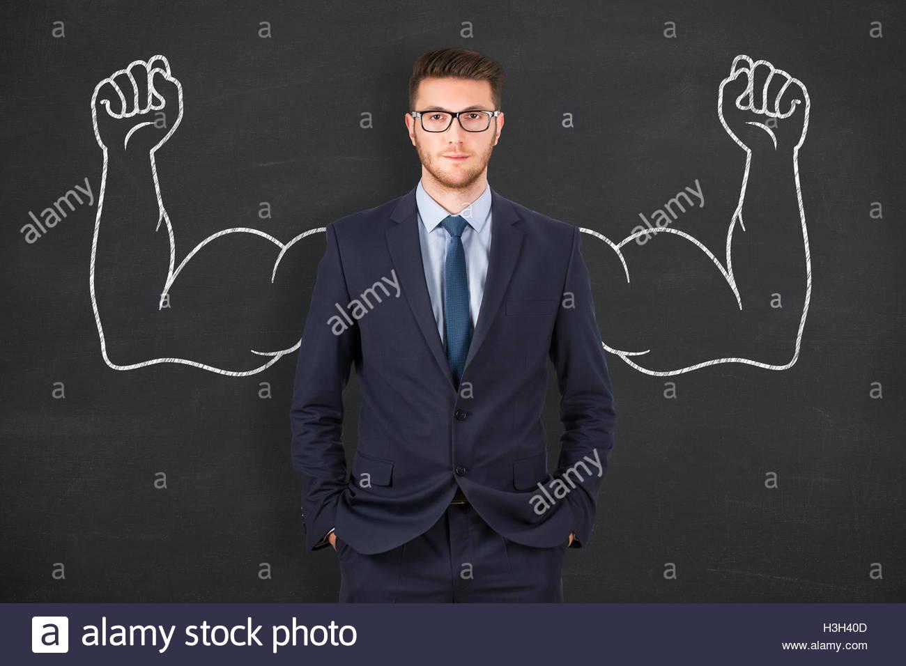 L'homme d'affaires sur l'arrière-plan du tableau Banque D'Images
