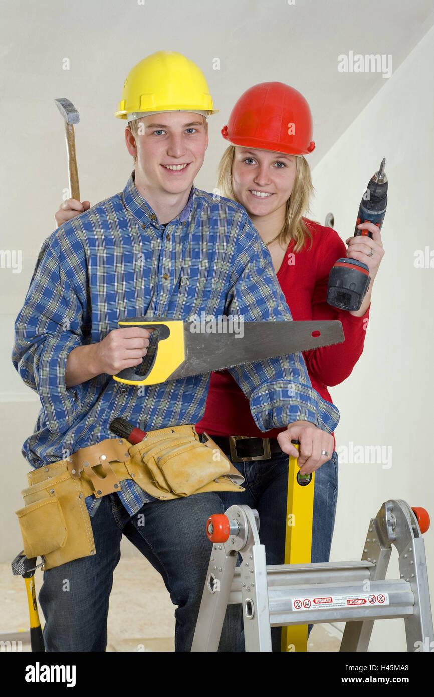 90819eaa202b Couple, jeune, sourire, casques de construction, d outils, l icône,  faites-le vous-même, personne, la mise à niveau, la construction, l homme  au travail, ...