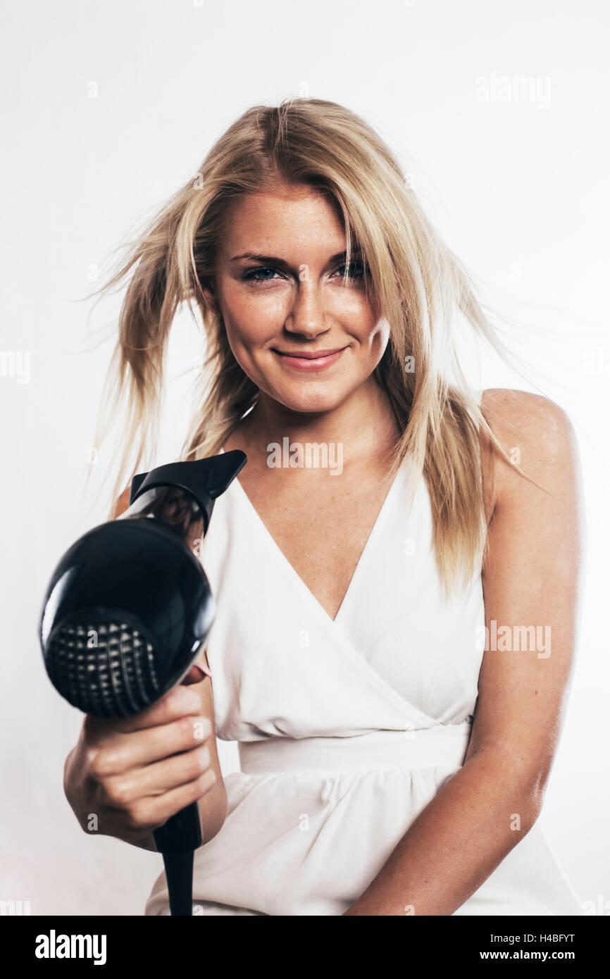 Woman brushing her hair Photo Stock