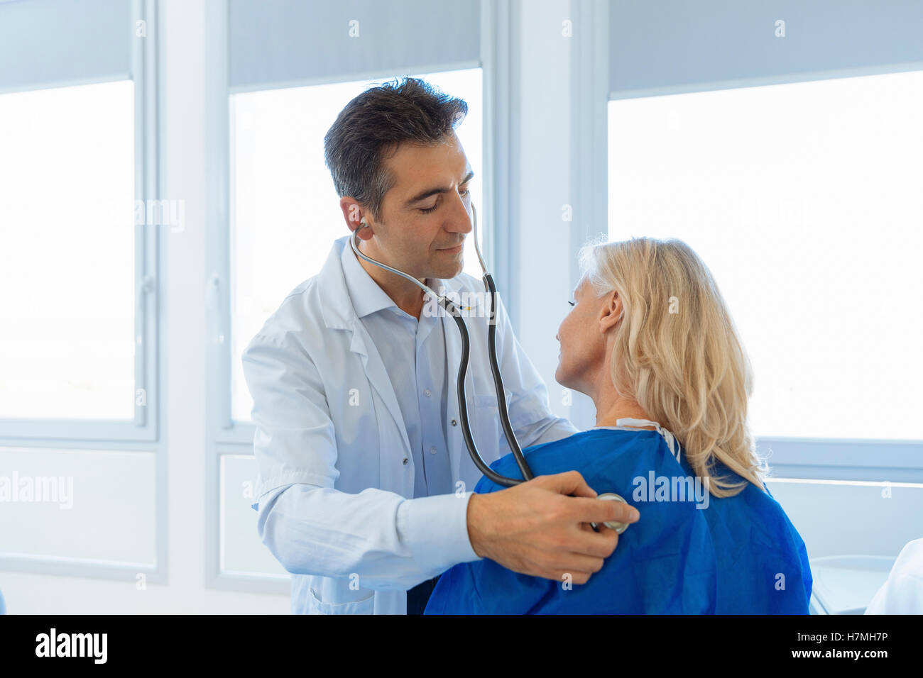 Doctor examining senior patient in hospital Photo Stock