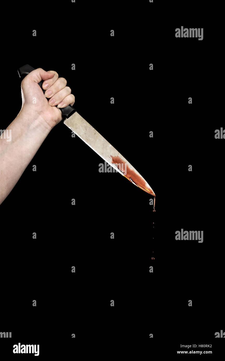 La main avec le couteau sanglant Photo Stock