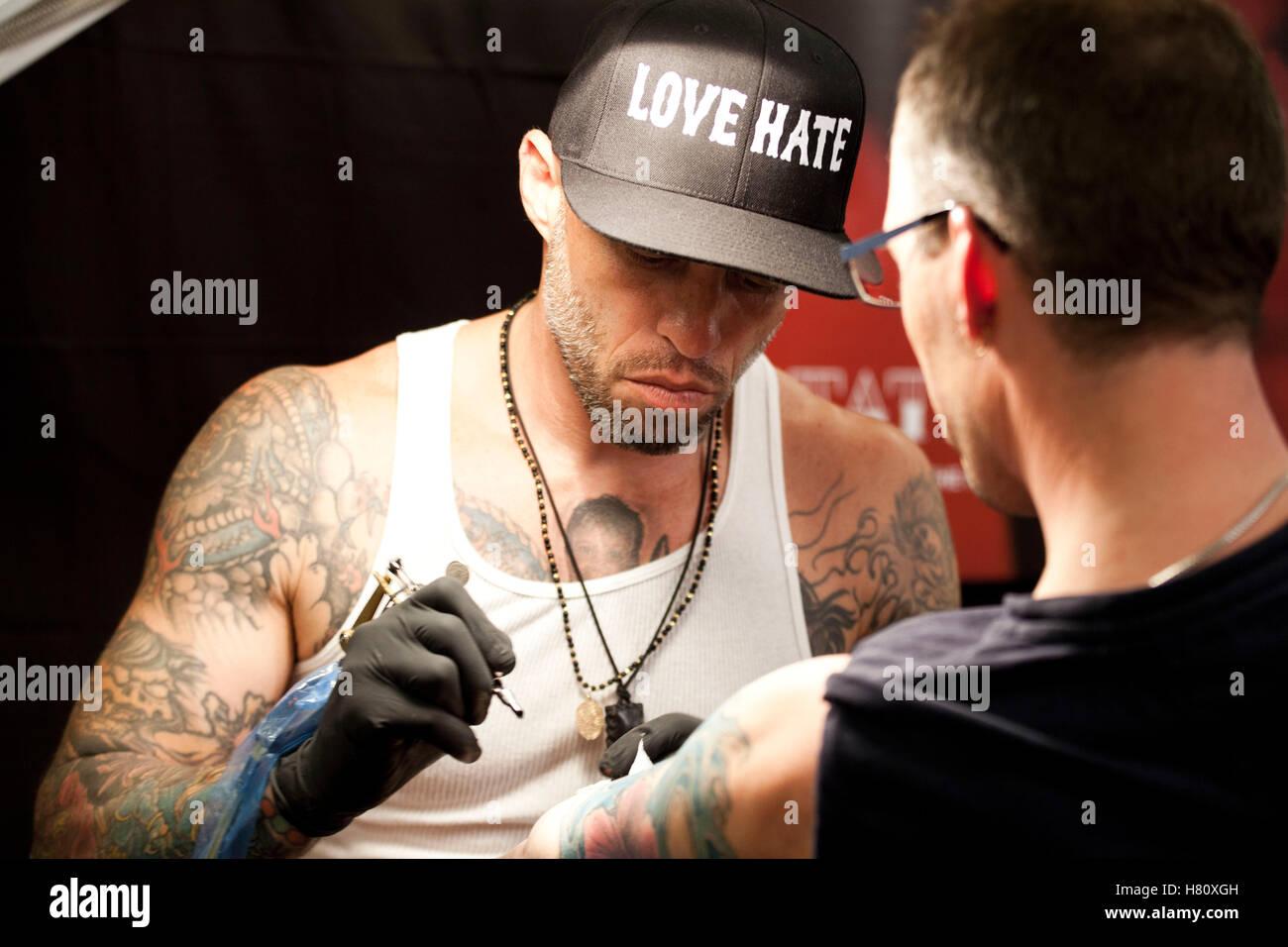 Tatoueur Ami James assiste à la convention de tatouage Encre Copenhague 2013. Photo Stock