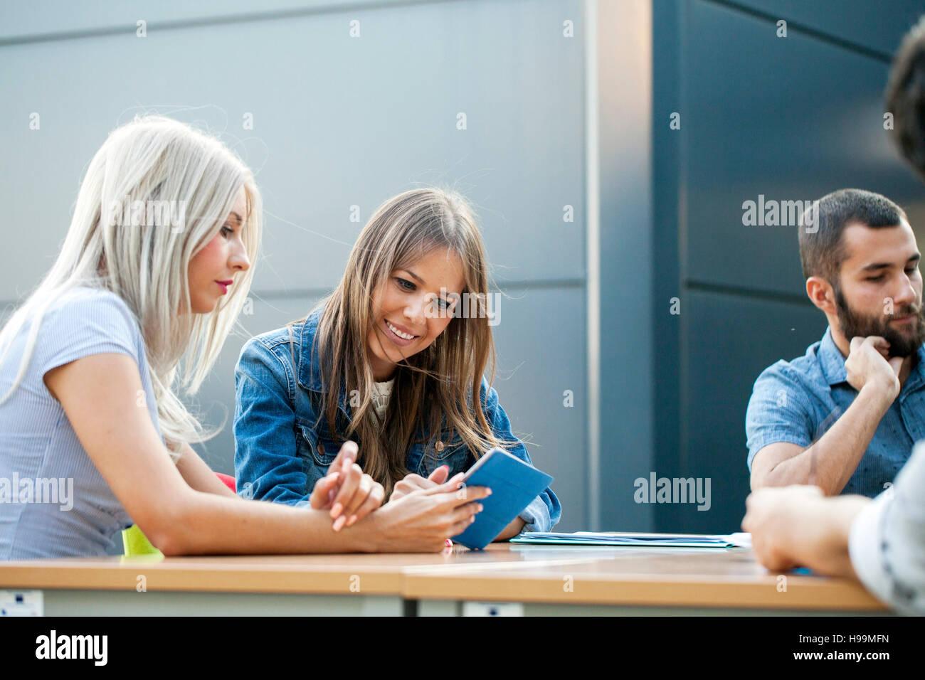 Businesswomen using digital tablet in workshop Photo Stock