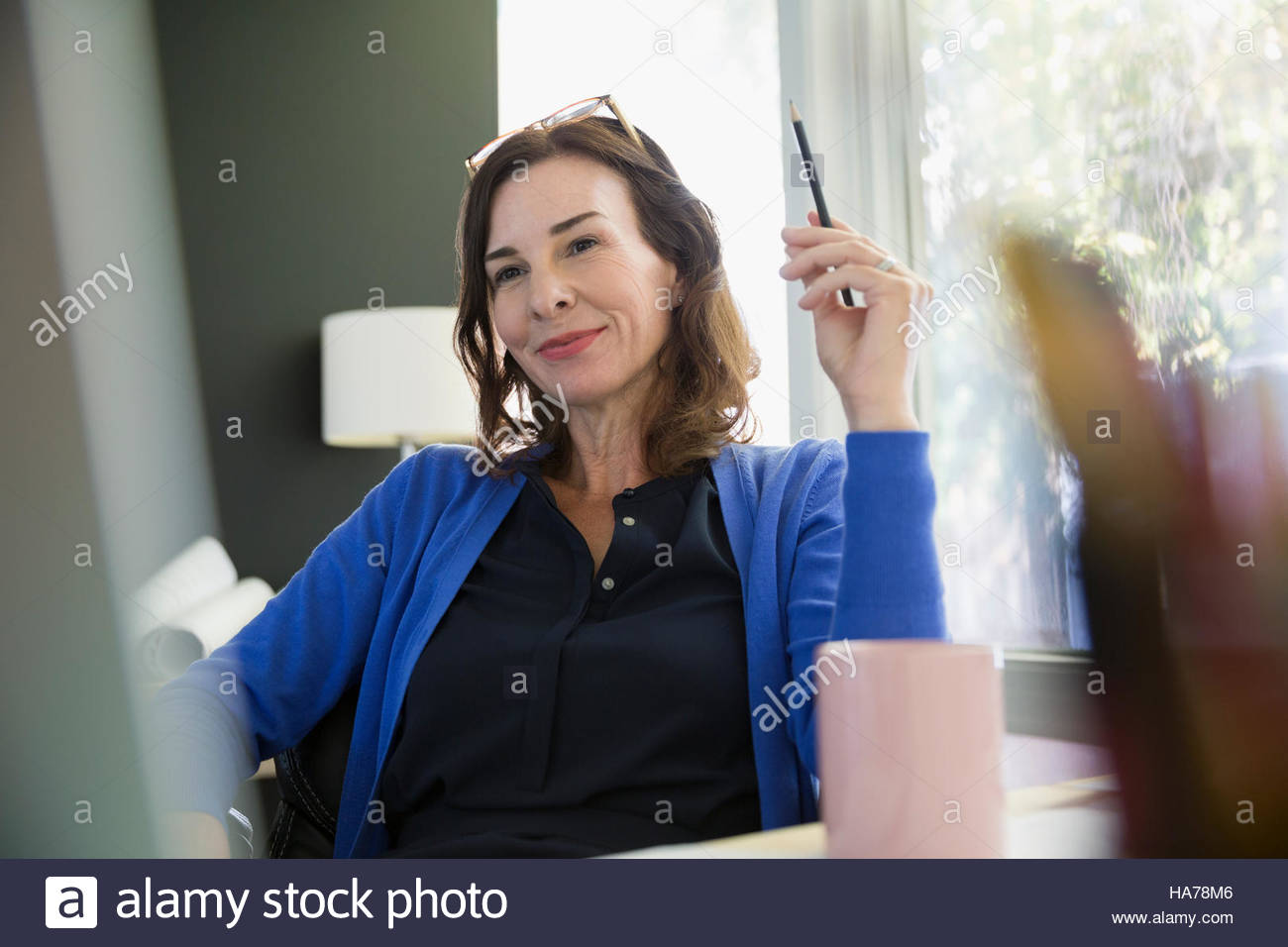 Confident businesswoman in office Photo Stock