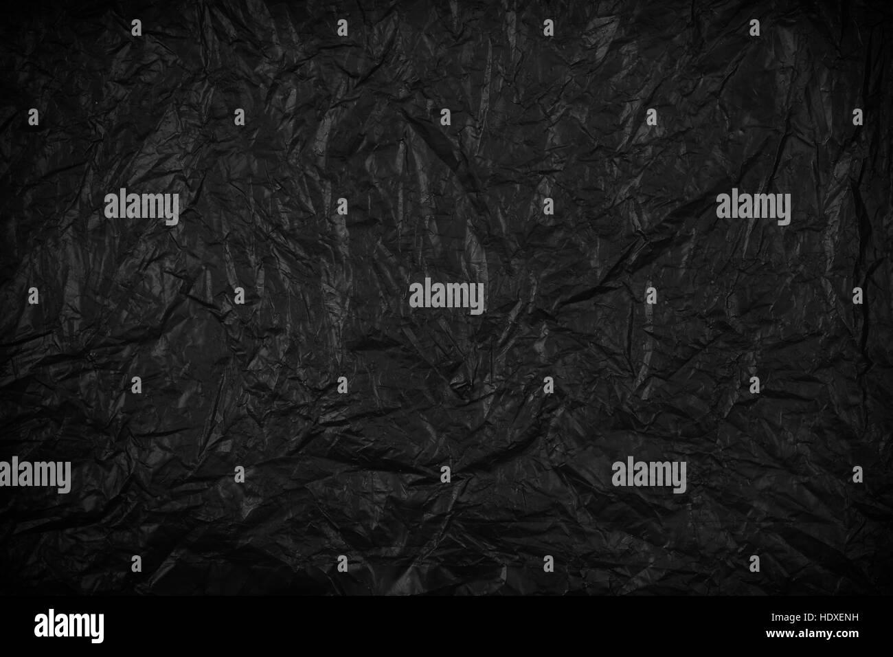 Résumé fond noir ou la texture du papier froissé Photo Stock