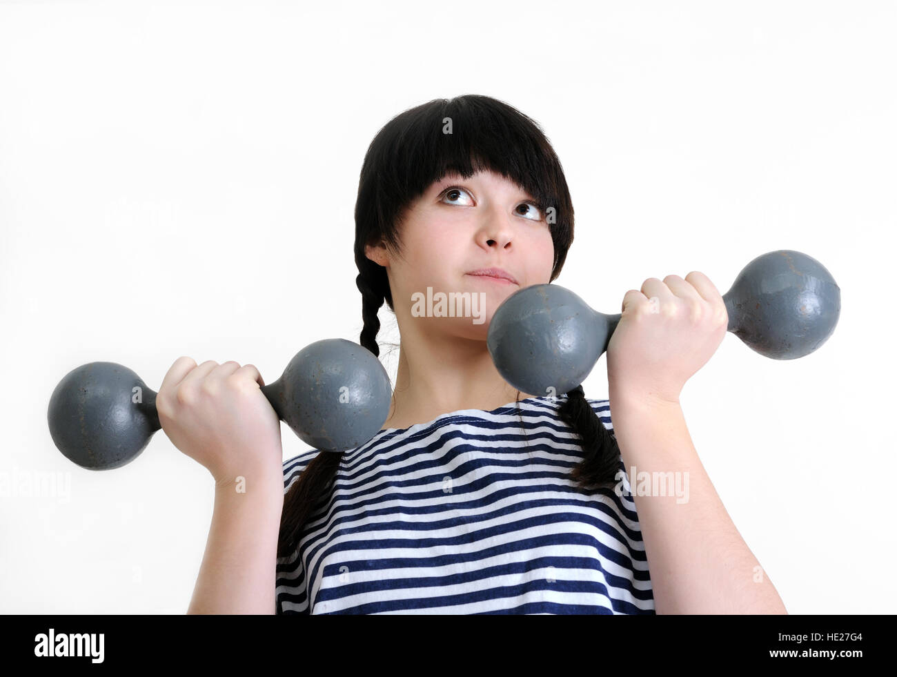 Young woman exercising with dumbbells deux vieux Photo Stock
