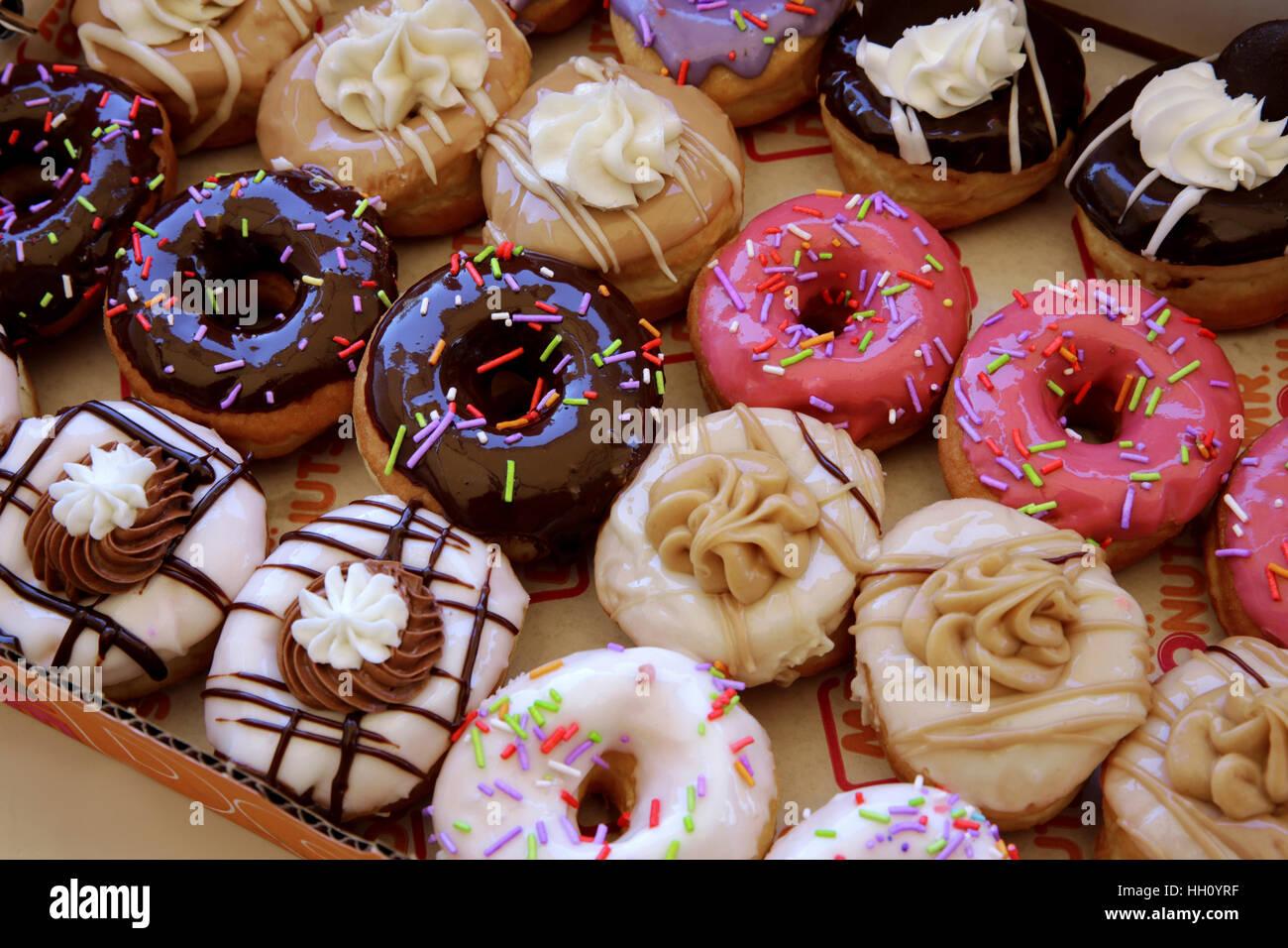 Donuts colorés enrobés de sucre Photo Stock