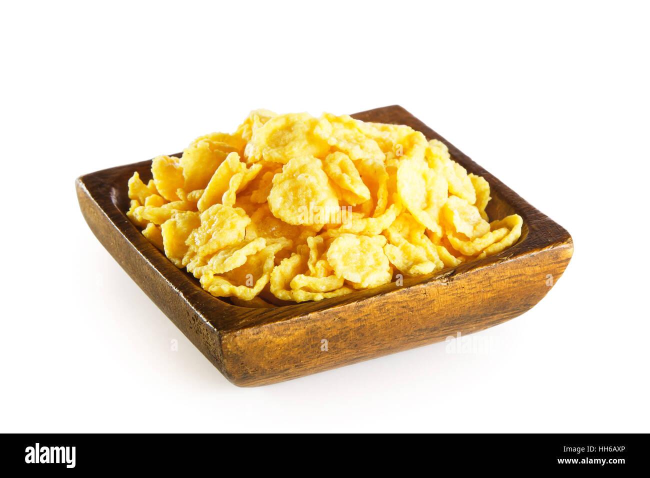 Des Cornflakes dans bol en bois isolé sur fond blanc Photo Stock