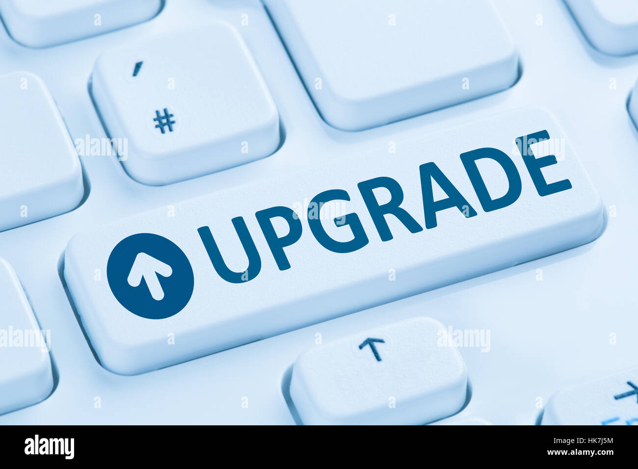 Programme de mise à niveau mise à niveau logiciel bleu symbole clavier de l'ordinateur Photo Stock