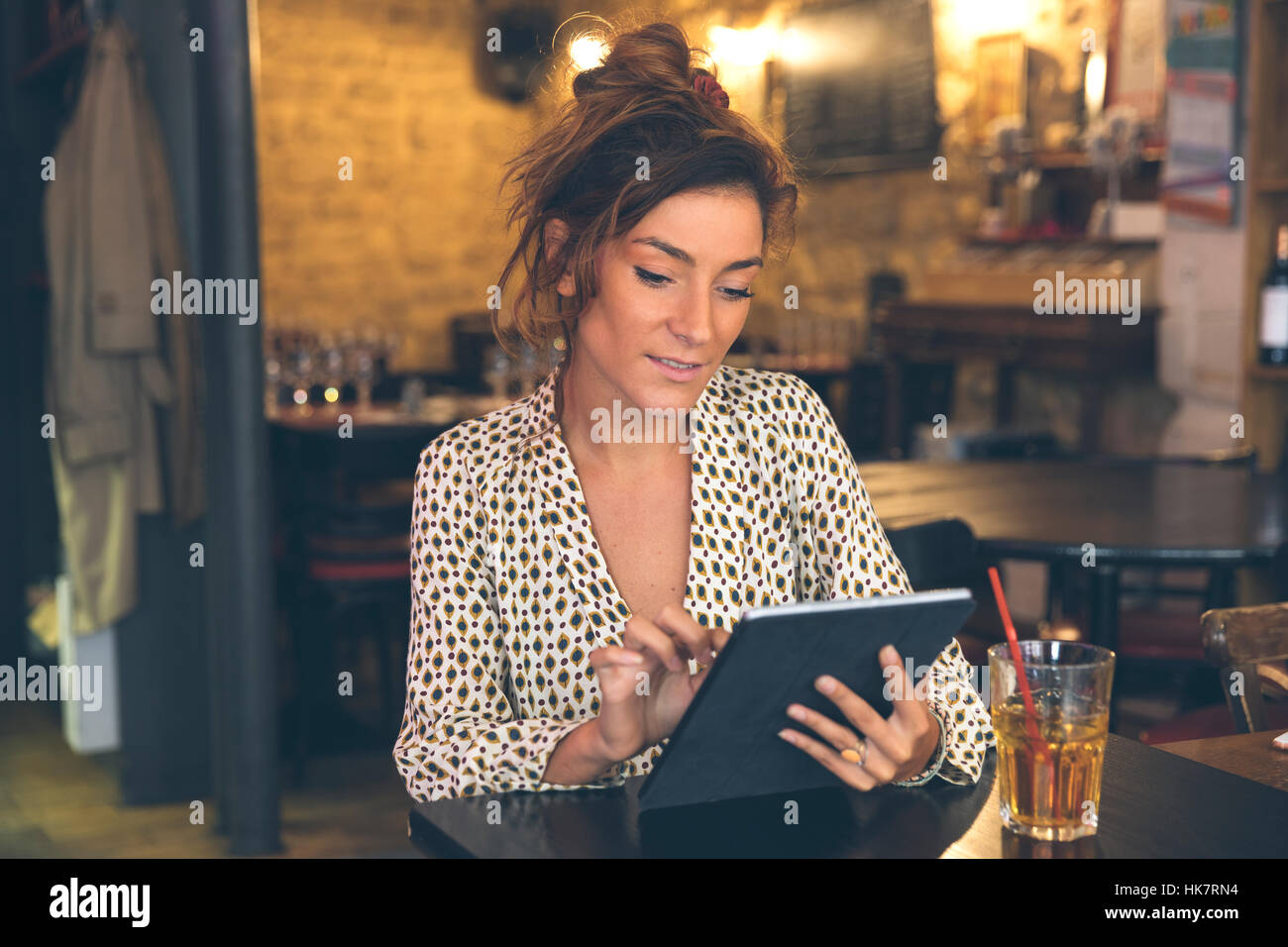 Woman using a Tablet pc in coffee shop Photo Stock