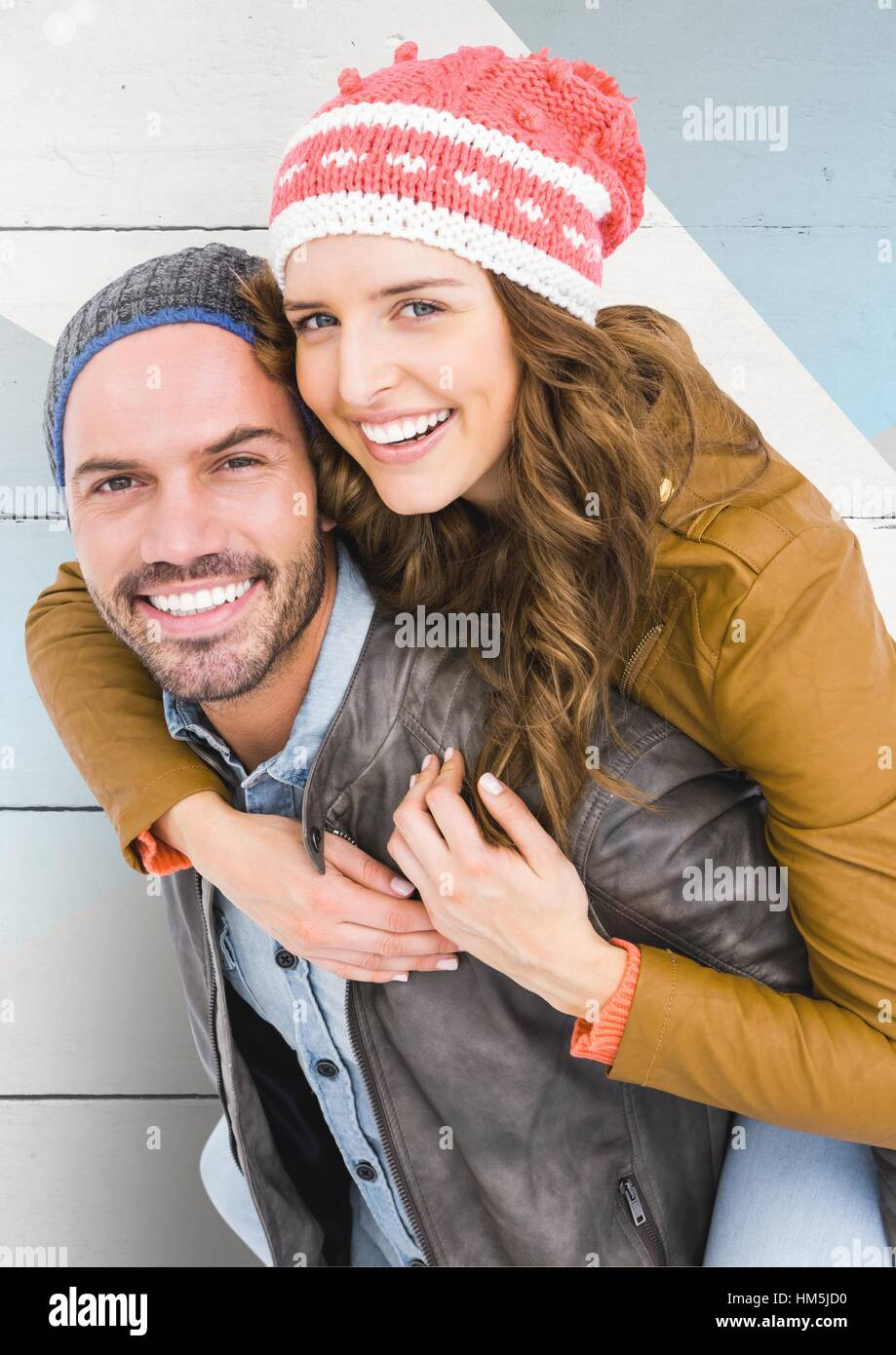 Portrait of happy man giving piggy back to woman Photo Stock
