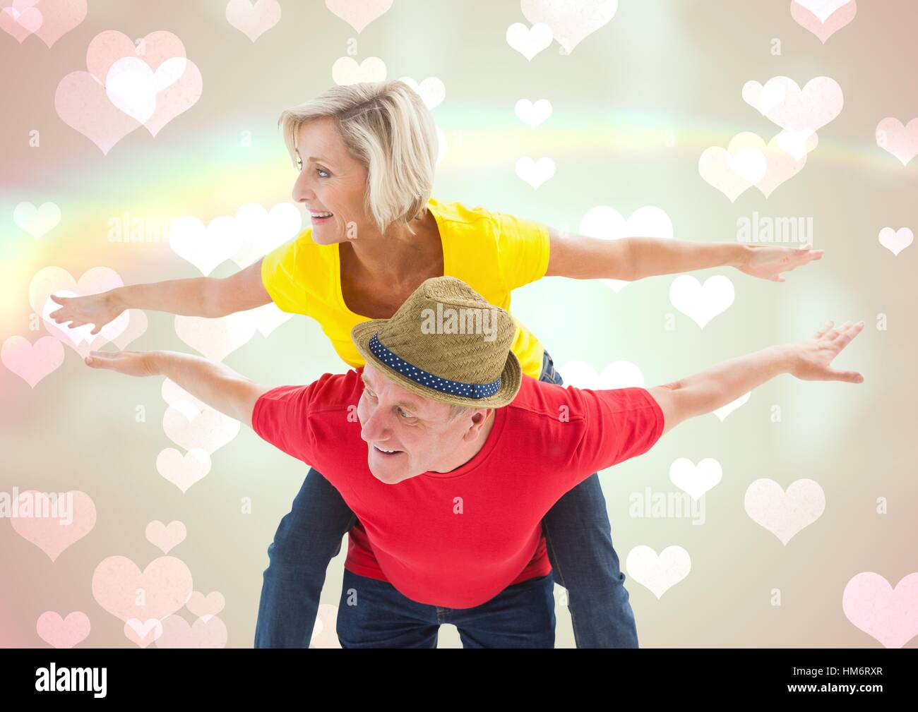 Homme mature donnant piggy back to woman Photo Stock