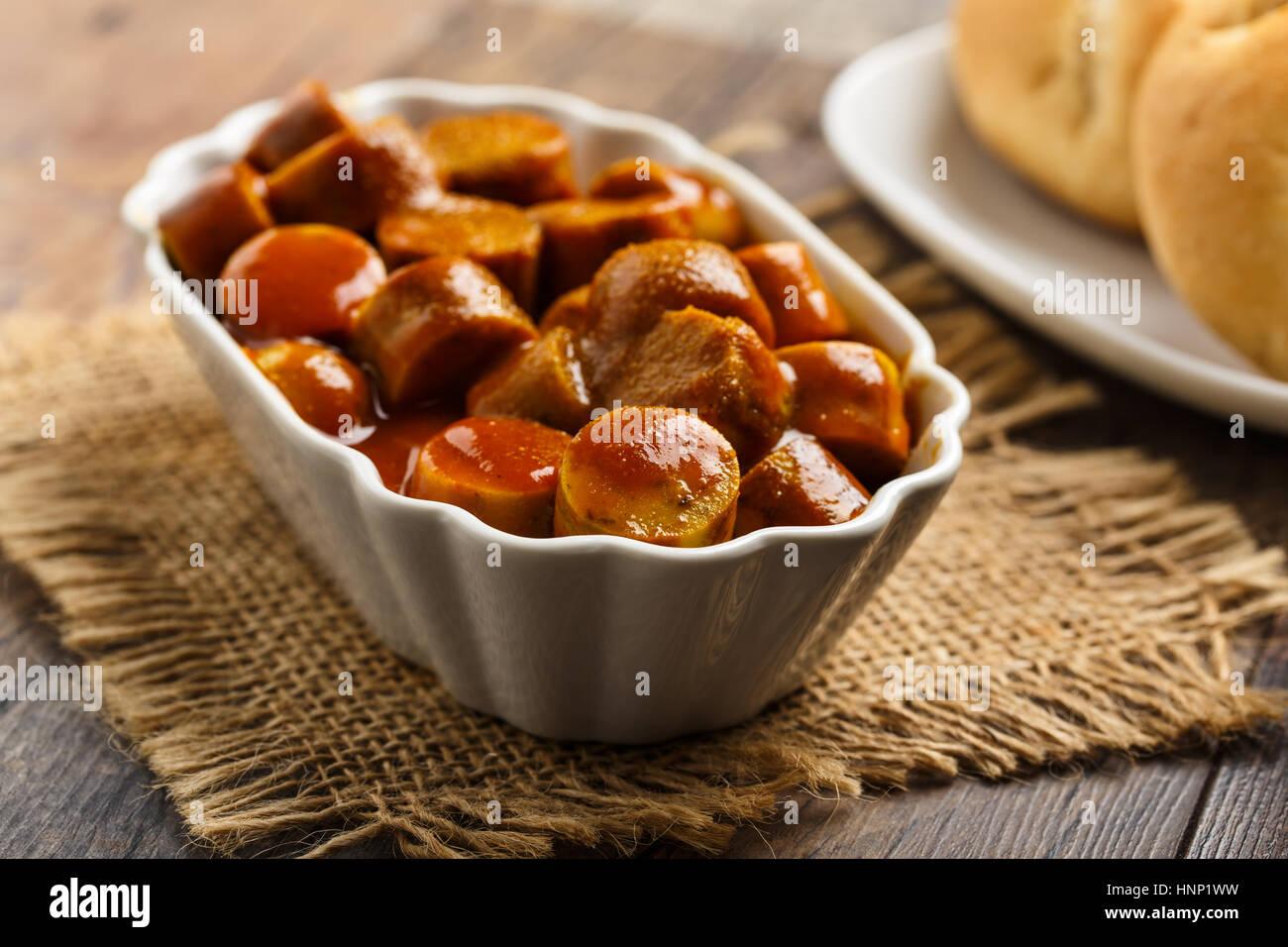 Currywurst allemande - morceaux de saucisse au curry Photo Stock
