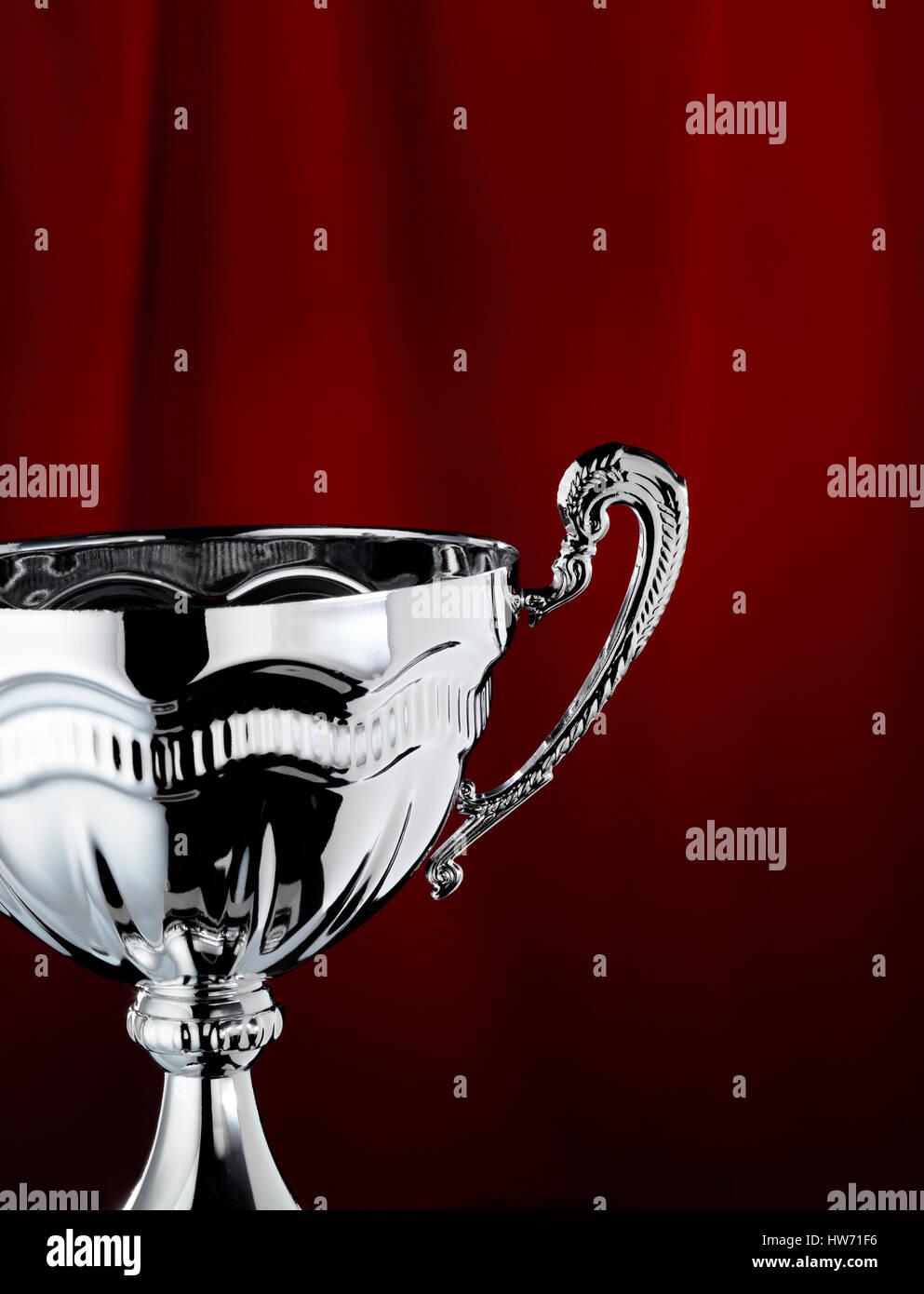Trophée avec un rideau rouge contexte Photo Stock
