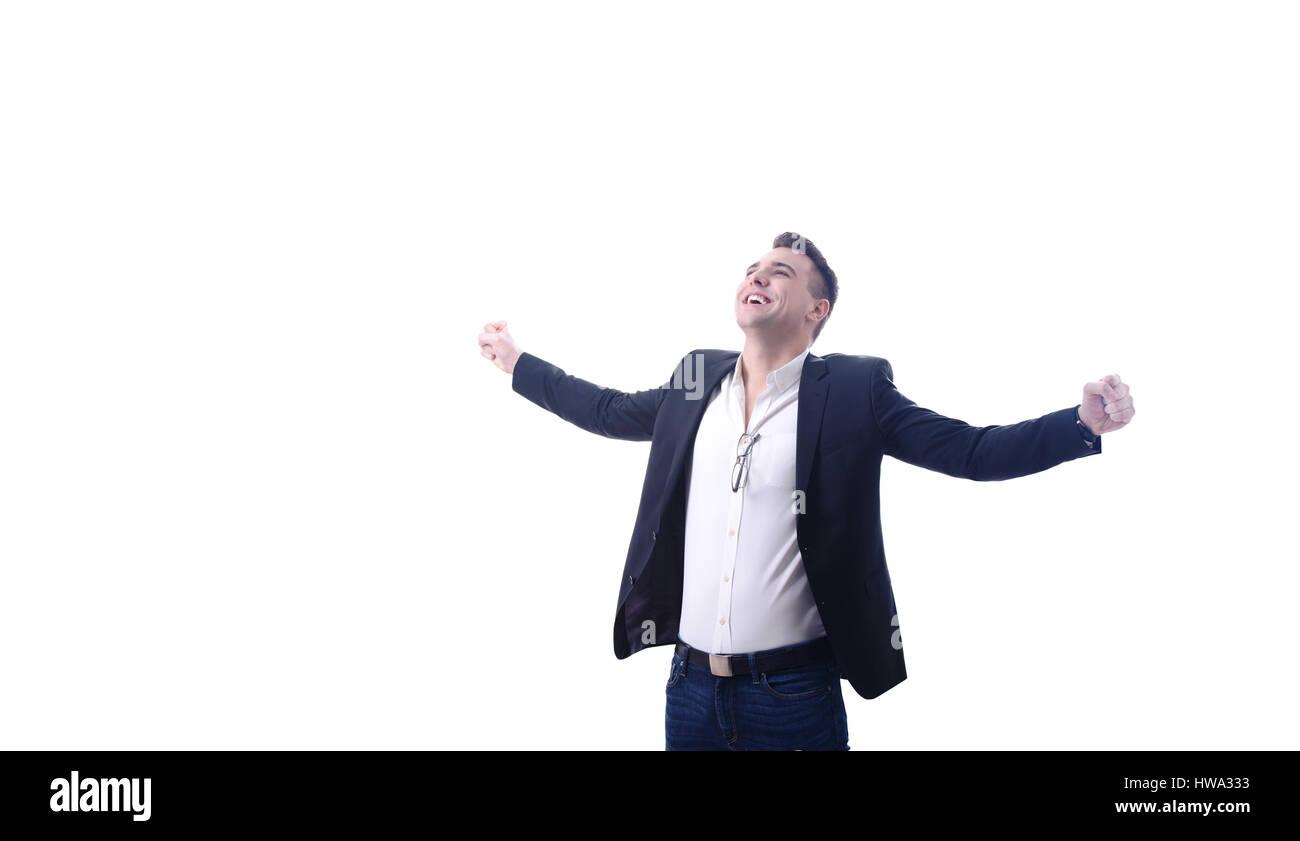 Jeune homme d'affaires heureux des succès à célébrer avec les bras outstreched studioshot Photo Stock