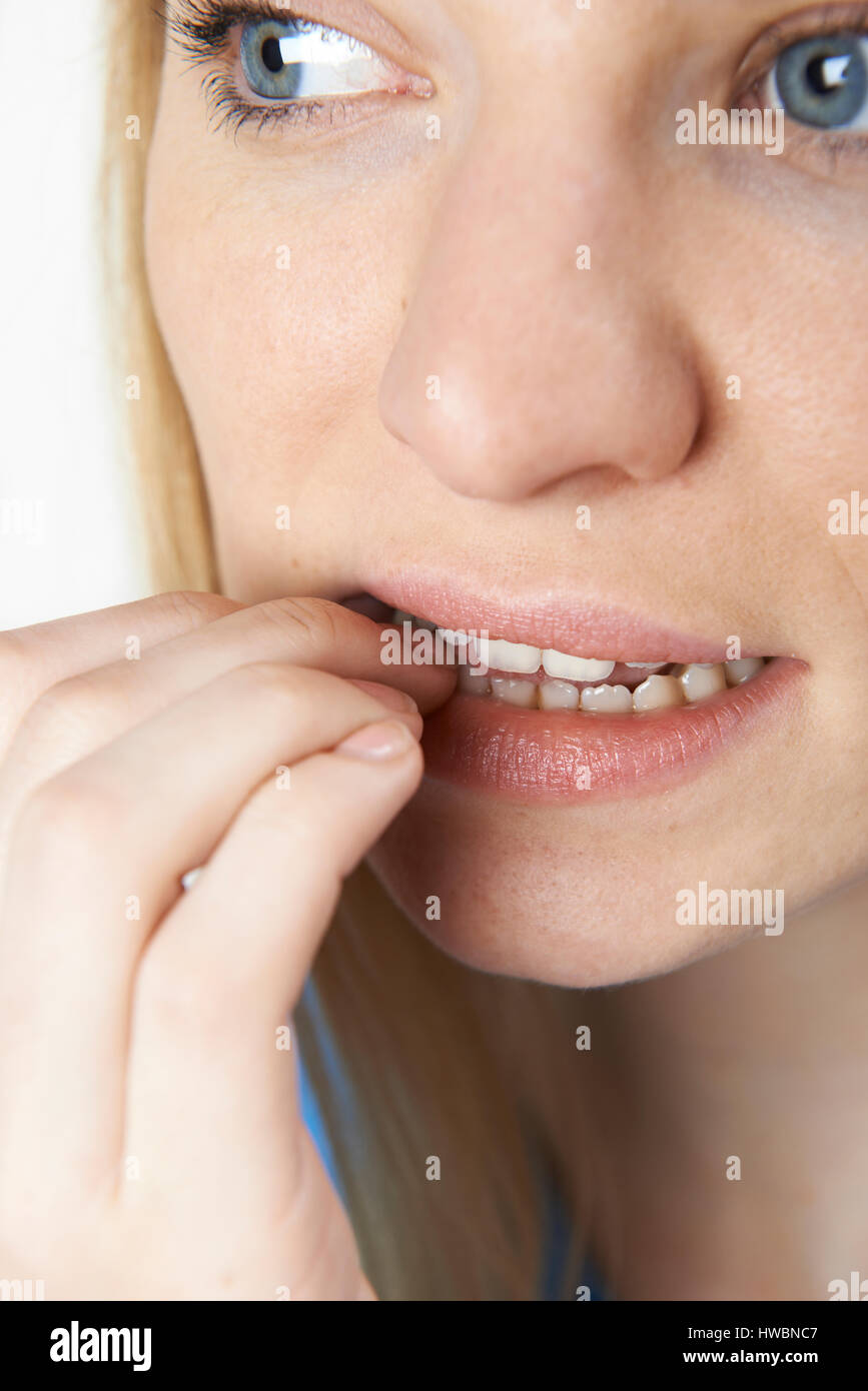 Close Up of Nervous Woman Biting Nails Photo Stock