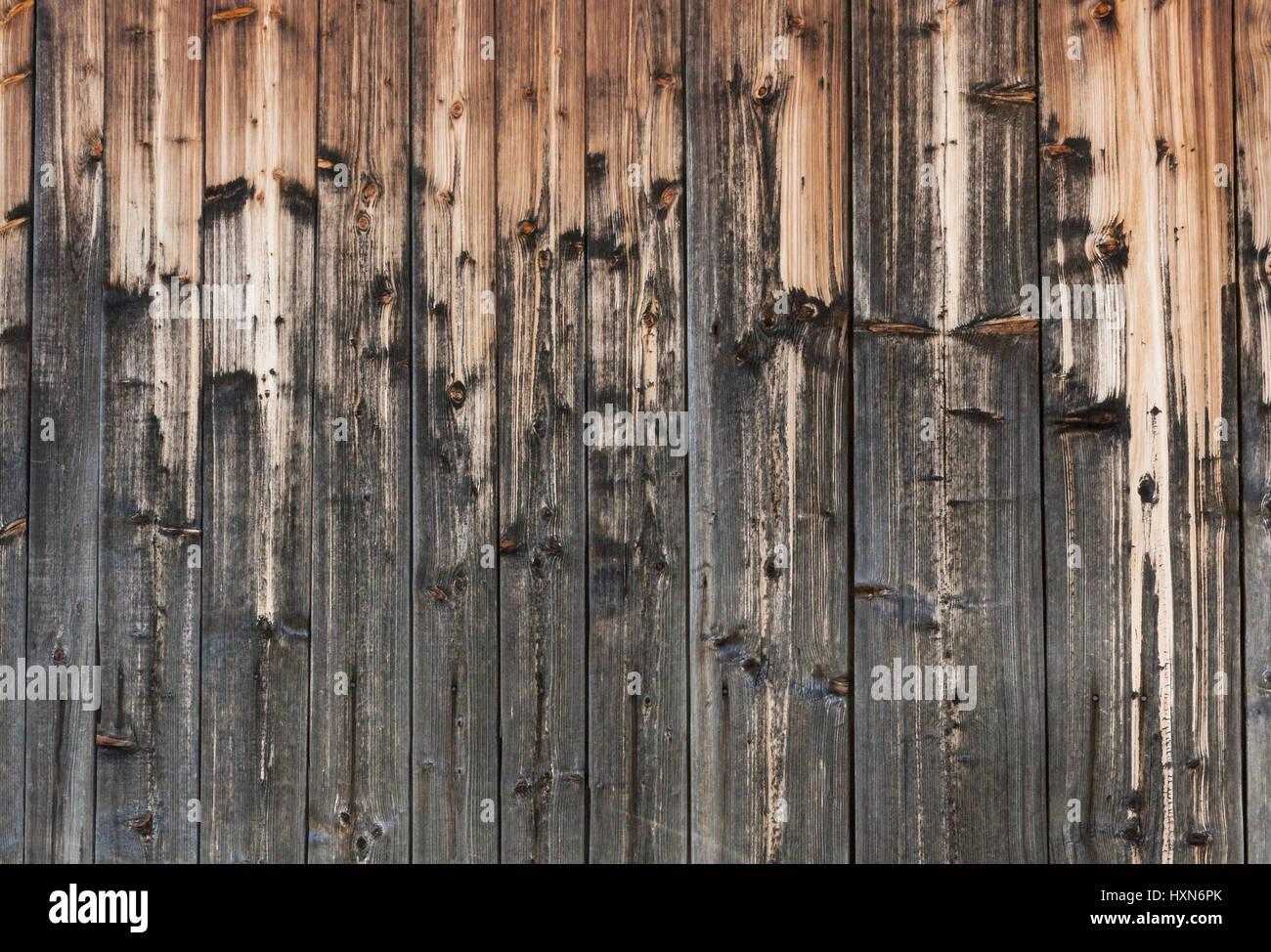 Arrière-plan de vieux bois peint magnifiquement avec le temps et les précipitations naturelles bandes. Photo Stock