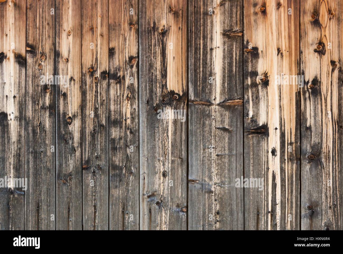 Arrière-plan de vieux bois décoloré et magnifiquement de temps précipitations naturelles bandes. Photo Stock