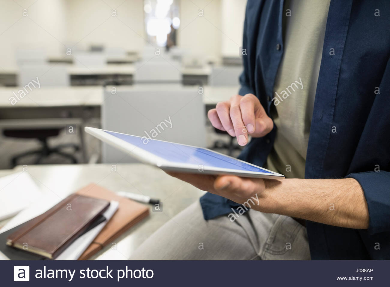 Close up businessman using digital tablet in classroom Photo Stock