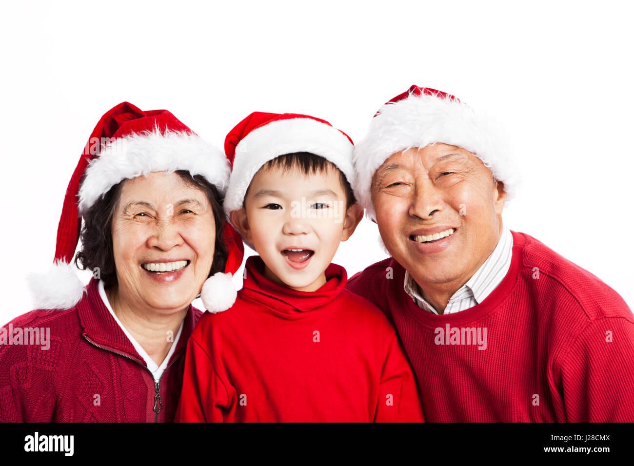 Un des grands-parents de célébrer Noël avec leur petit-fils Photo Stock