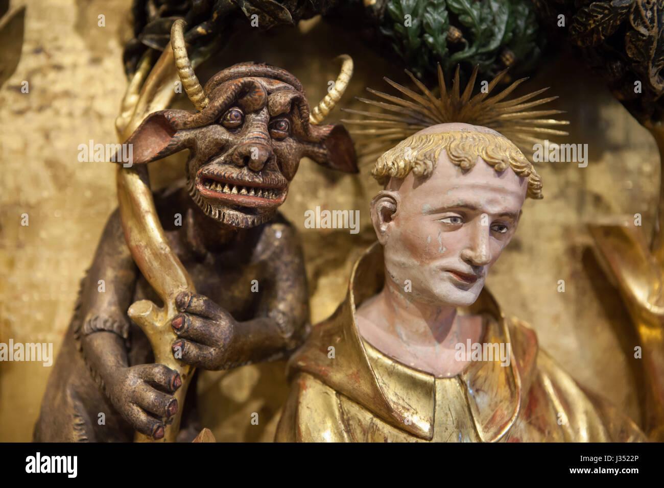 La Tentation de Saint Antoine. Détail du retable des Saints et des Martyrs de la Chartreuse de Champmol par Photo Stock