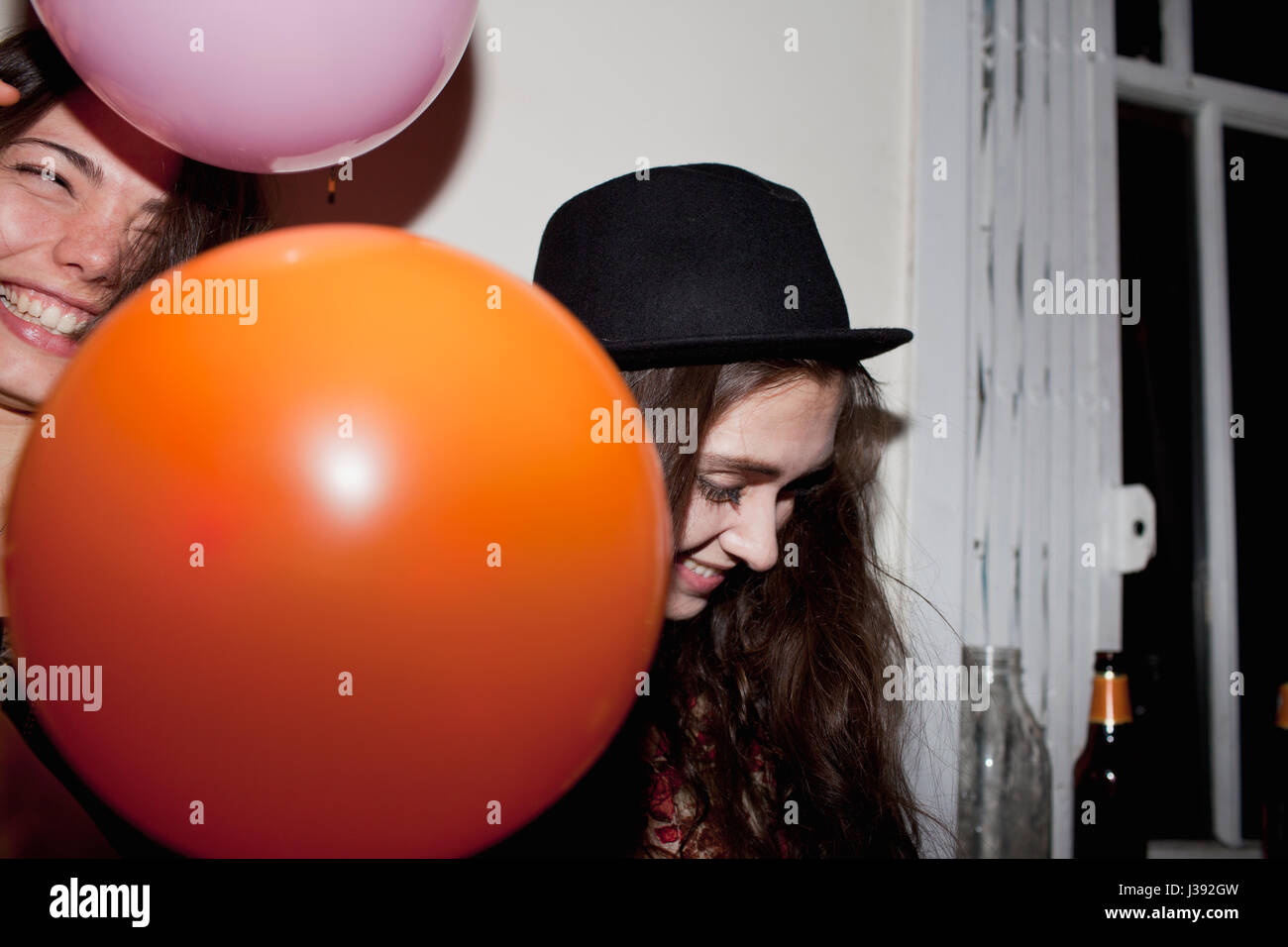 Friends hanging out at a party Photo Stock