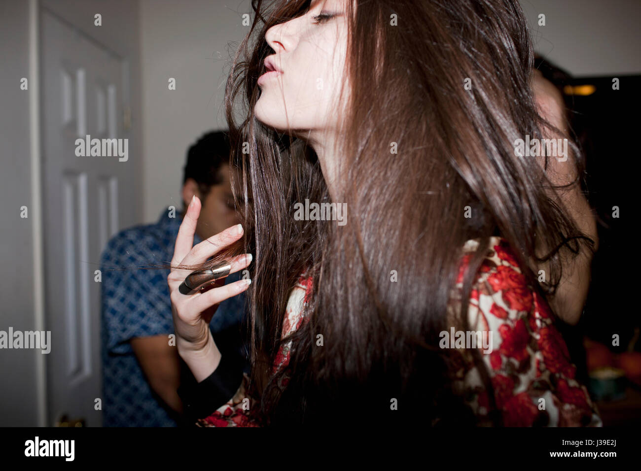 Young woman dancing at a party Photo Stock