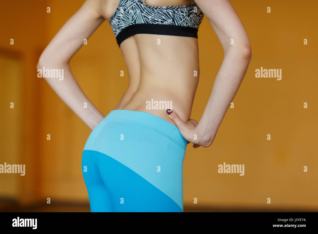 Athletic young girl at gym Photo Stock
