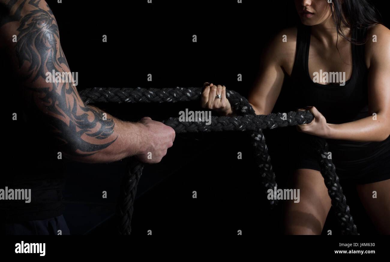 Tirant une corde - conflit et rivalité Photo Stock