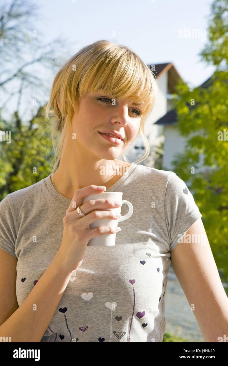 Personne, femme, modèle, parution de 20 à 30 ans, 30 à 40 ans, le café, boisson, le soleil du Photo Stock