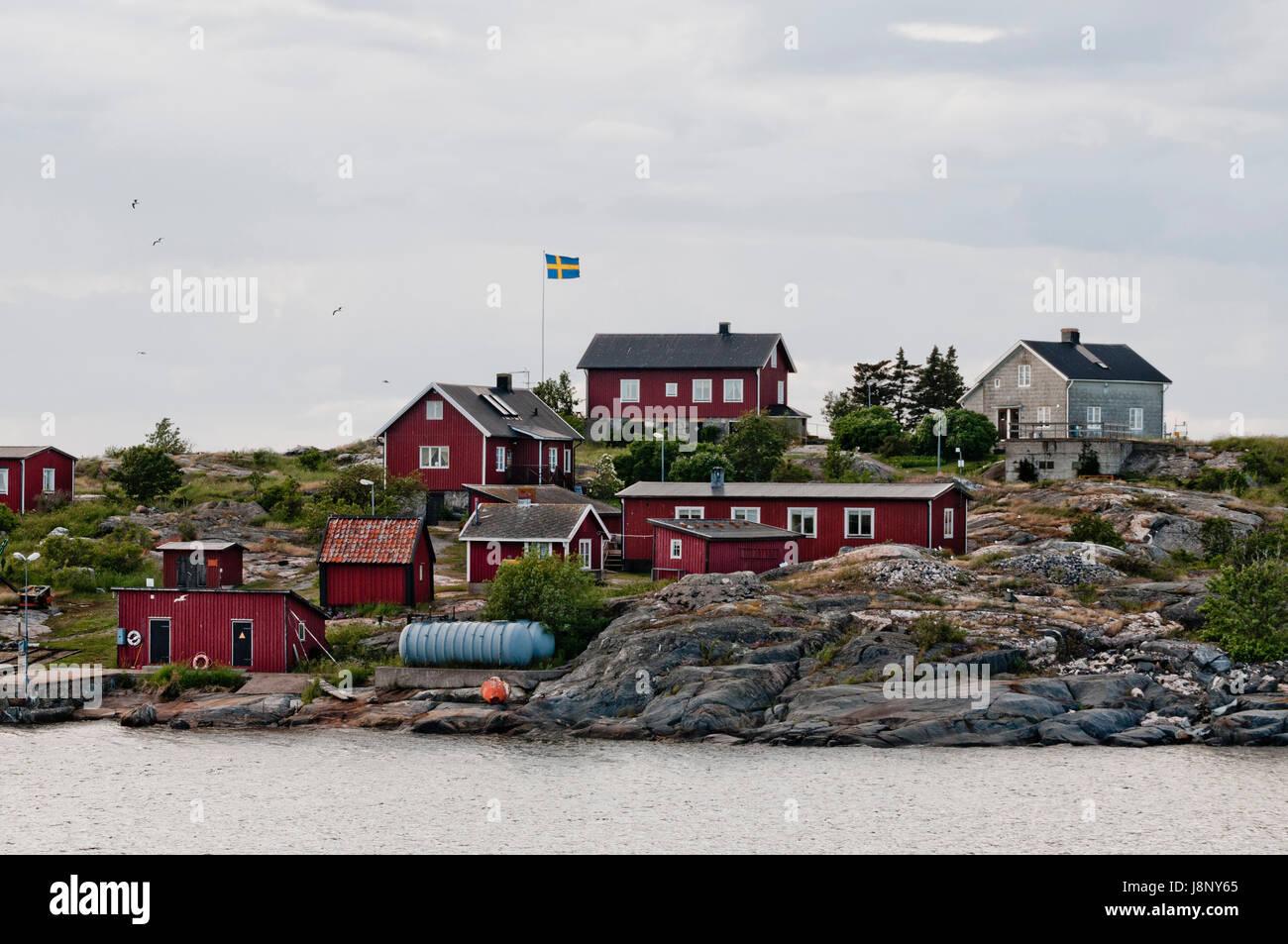 De petites maisons par la mer Banque D'Images