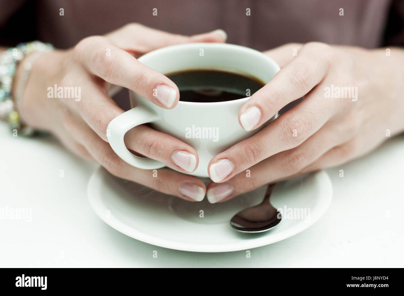 Woman having coffee Banque D'Images