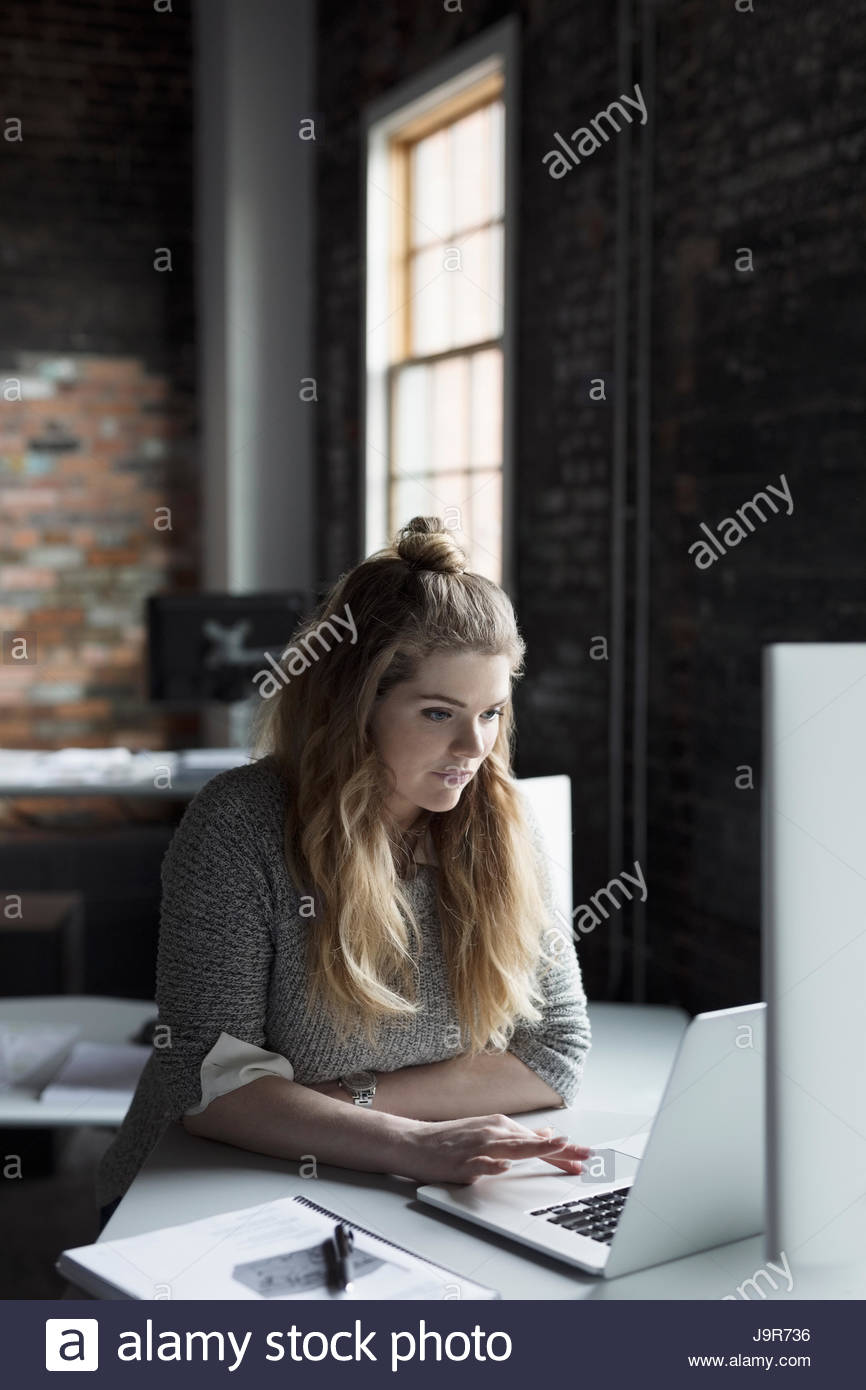 Creative businesswoman working at desk in office Photo Stock