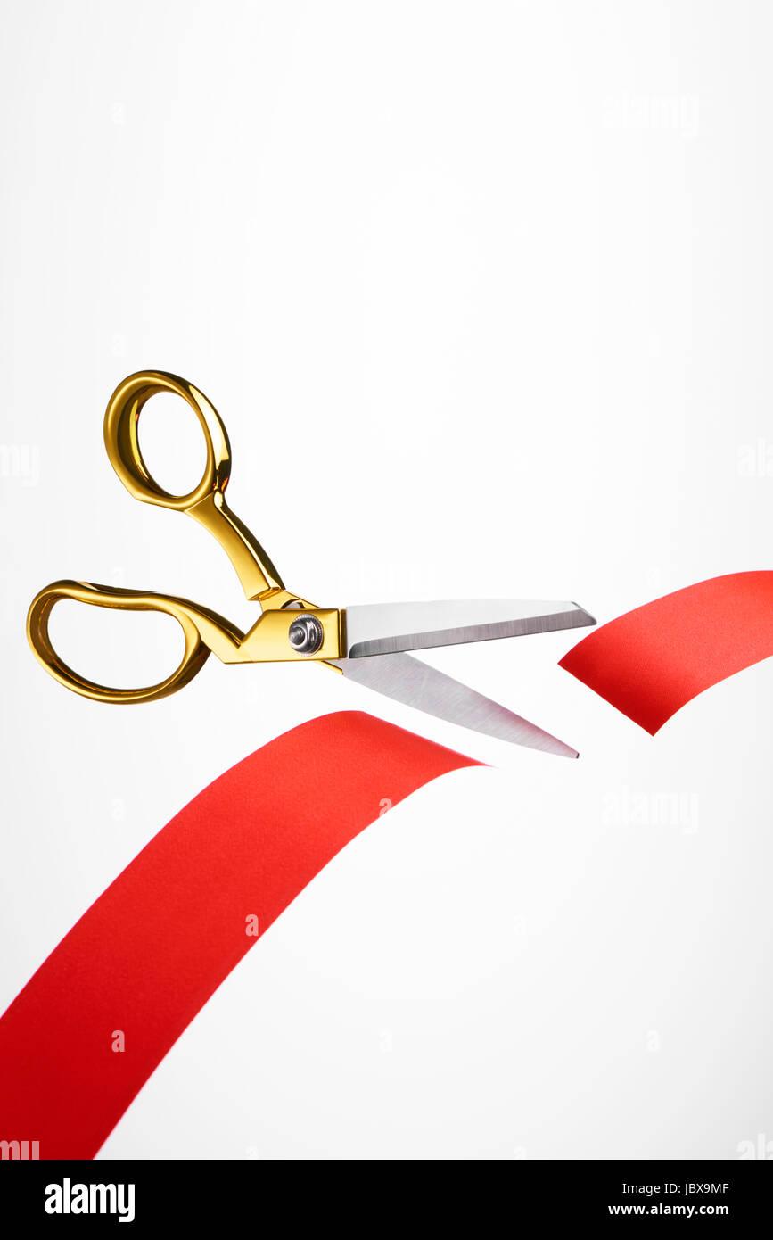 Or ruban rouge ruban coupe/ Photo Stock