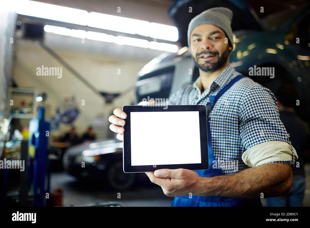 Mécanicien avec surface tactile Photo Stock
