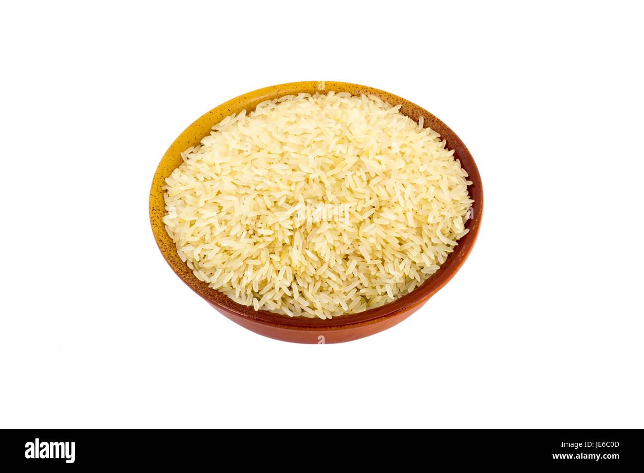 Dans un bol de riz cuit à la vapeur sur un fond blanc Photo Stock