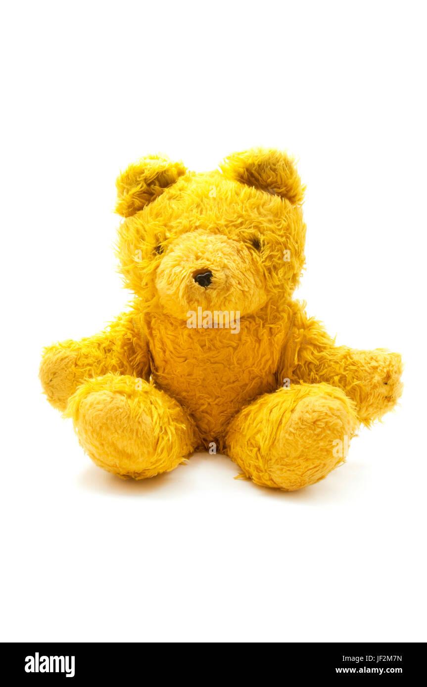 Ours en peluche jaune sur fond blanc Banque D'Images