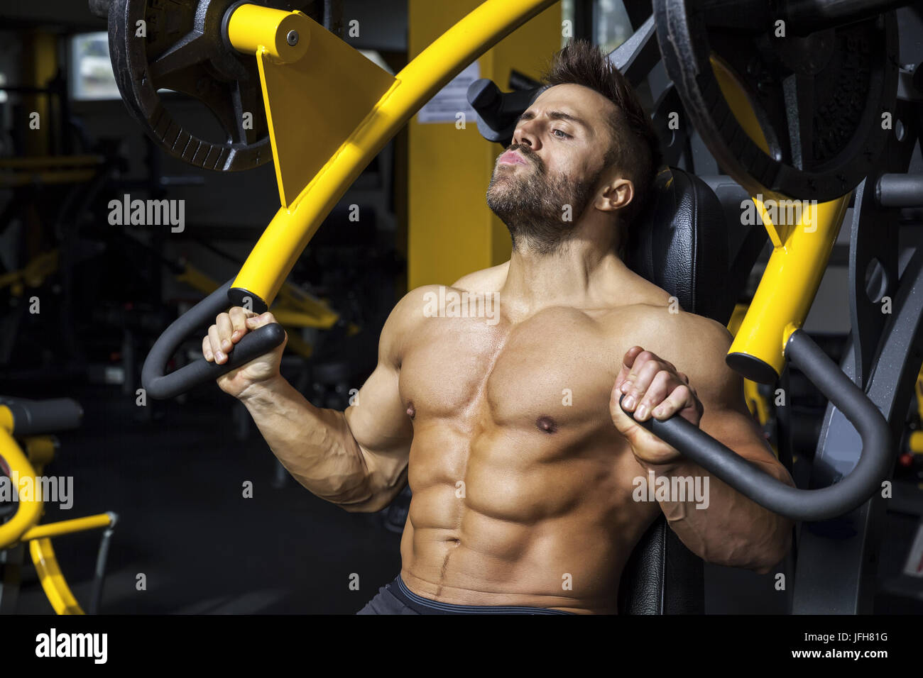 Handsome man bodybuilding barbu Photo Stock