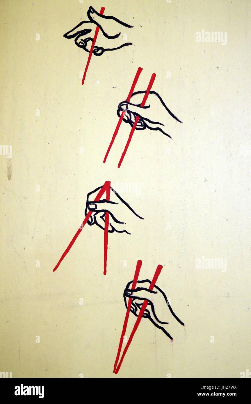 Peinture murale de la rue. L'utilisation de baguettes. Singapour. Photo Stock