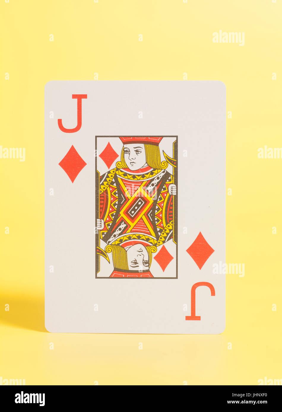 Valet de coeur carte à jouer sur un fond jaune Photo Stock
