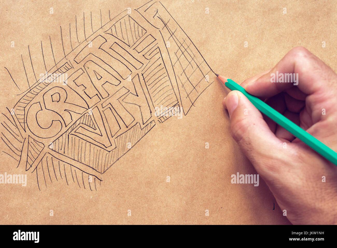 La créativité en design graphique, illustration et l'écriture avec un crayon à la main et les hommes Banque D'Images