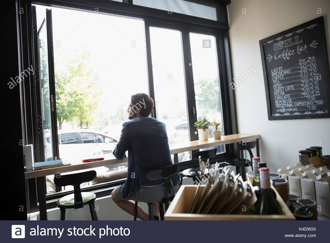 Pensive man sitting in cafe Photo Stock