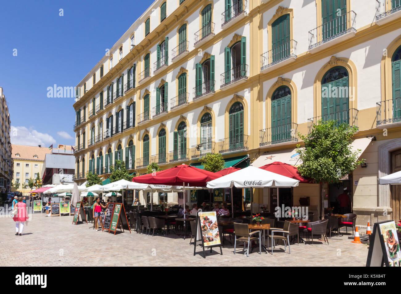 Les cafés de la Plaza de la Merced, Malaga, Espagne Banque D'Images