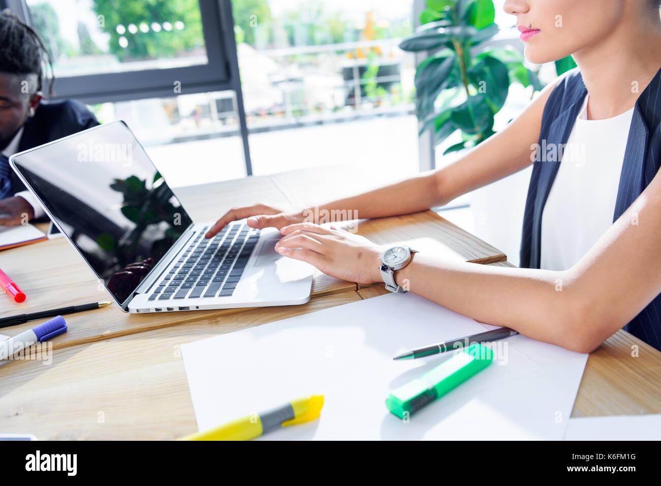 Businesswoman using laptop Photo Stock
