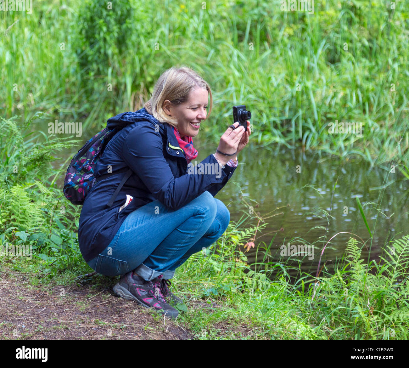 Young woman taking photograph Photo Stock